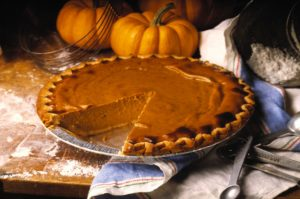 Pumpkin Pie with Slice Removed --- Image by © Envision/Corbis